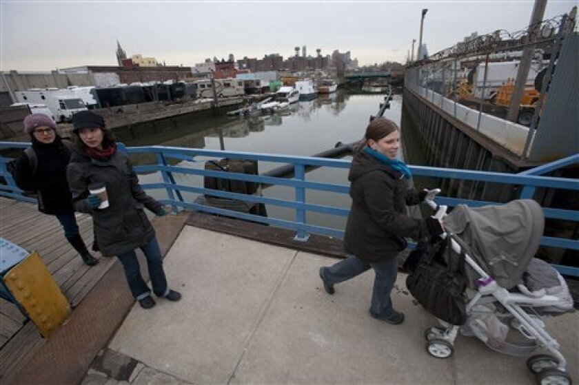 From left to right, Mira Oreck, Tamar Huberman, and Sara Kanby, cross the Gowanus Canal in the Brooklyn borough of New York on Tuesday, March 2, 2010. The Environmental Protection Agency announced Tuesday the Gowanus Canal is the nation's newest superfund site. (AP Photo/Mark Lennihan)