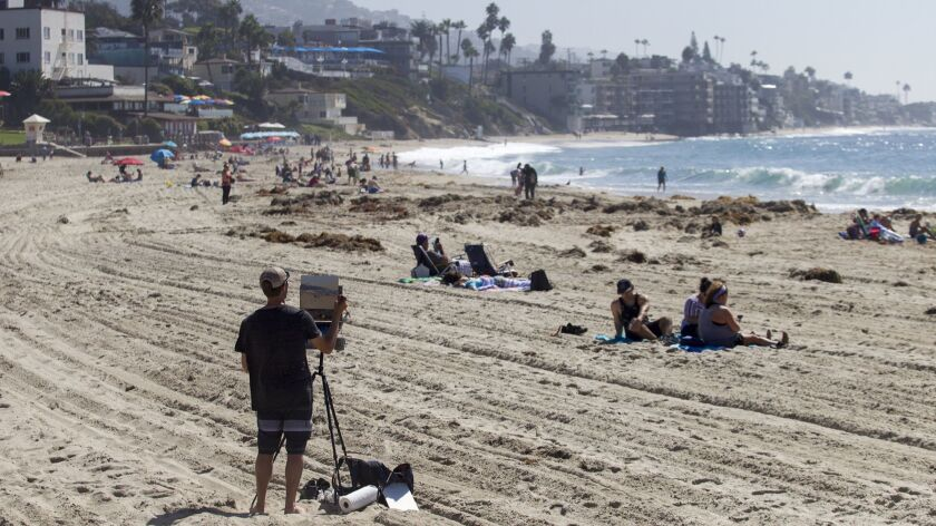 Jesse Bowell from Carmel-by-the-Sea paints a scene on Main Beach in Laguna Beach on Tuesday, October