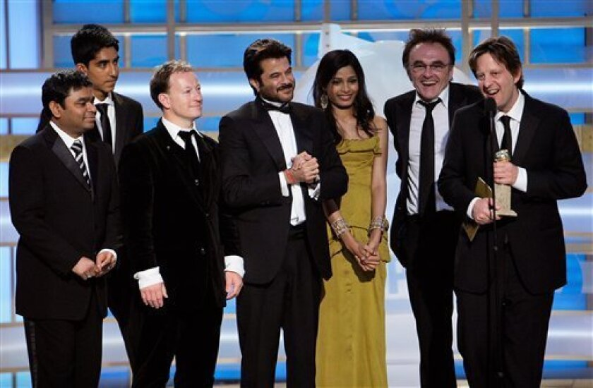 """In this handout image, provided by NBC, the cast and crew of """"Slumdog Millionaire"""" accept the award for Best Motion Picture - Drama on stage during the 66th Annual Golden Globe Awards on Sunday Jan. 11, 2009 in Beverly Hills, Calif. (AP Photo/NBC,Paul Drinkwater)"""