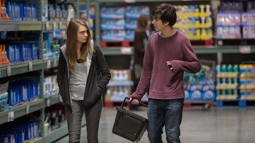 """Cara Delevingne, left, as Margo, and Nat Wolff as Quentin, in a scene from the new film, """"Paper Towns."""""""