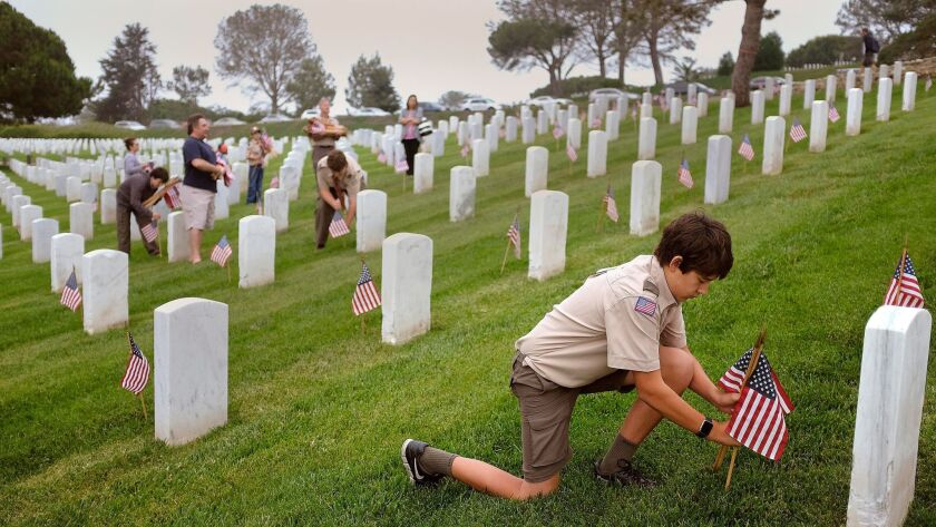 SAN DIEGO_|Cub Scouts and Boy Scouts from around the county placed American flags in the grass by ma