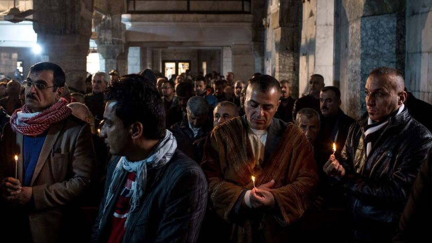 Iraqis attend Christmas Mass at the Mar Shimoni church in Bartella, a predominantly Christian town recently recaptured from Islamic State.