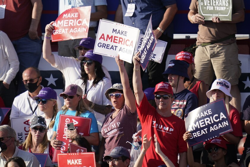 Supporters cheers as President Donald Trump speaks at a campaign rally Monday, Oct. 19, 2020, in Tucson, Ariz. (AP Photo/Ross D. Franklin)