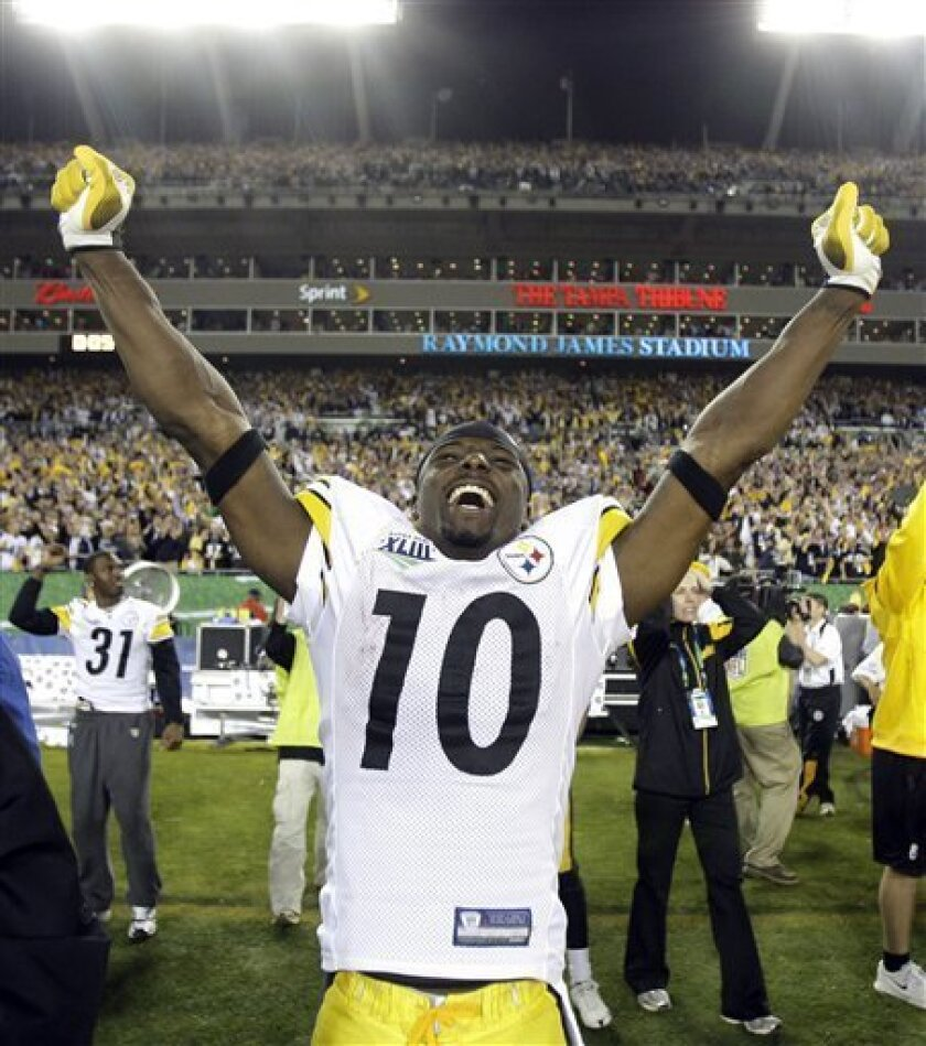 Pittsburgh Steelers wide receiver Santonio Holmes celebrates following Pittsburgh's 27-23 win over the Arizona Cardinals in the NFL Super Bowl XLIII football game, Sunday, Feb. 1, 2009, in Tampa, Fla. Holmes caught the game-winning touchdown pass. (AP Photo/Amy Sancetta)