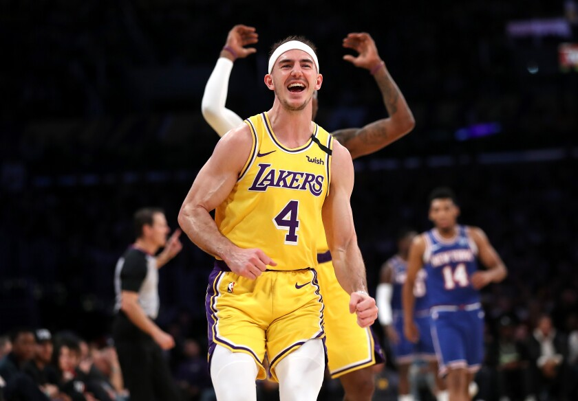 Lakers guard Alex Caruso celebrates against the New York Knicks.