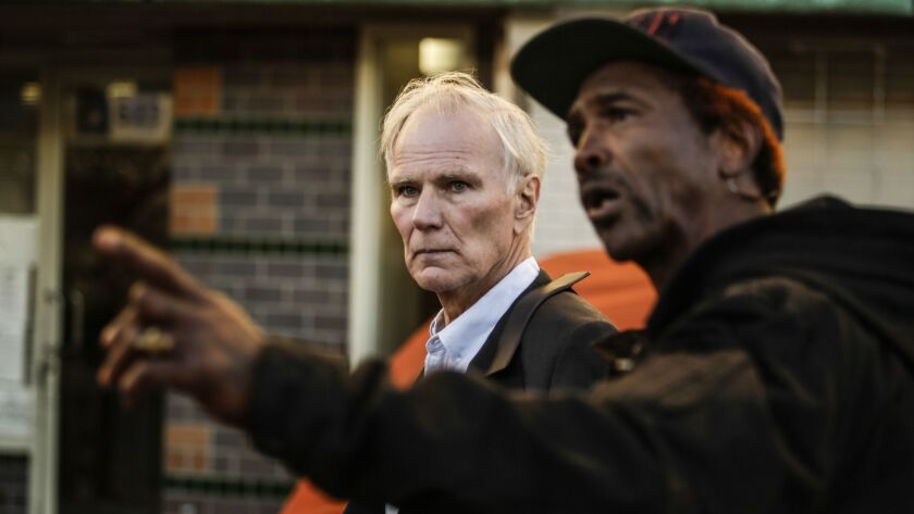 U.N. Special Rapporteur Philip Alston tours Los Angeles' skid row with General Dogon on Dec. 5.