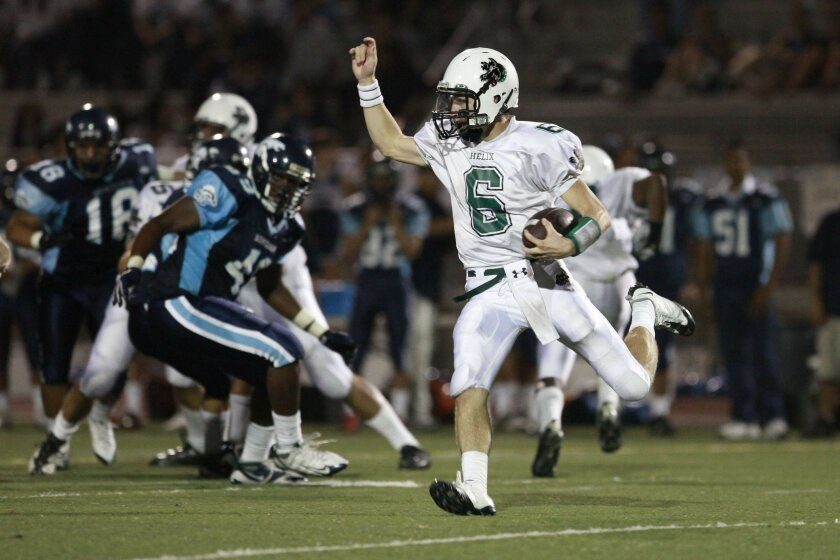 Helix quarterback Jake Reed scrambles for some of his 76 yards rushing vs. Otay Ranch.