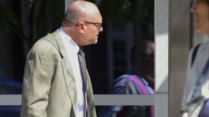 """Kevin Wallin, a former Catholic priest, enters the federal courthouse in Hartford, Conn., on Thursday. The former Bridgeport Diocese priest whose addiction and drug dealing earned him the nickname """"Monsignor Meth,"""" was sent back to prison for failing another drug test."""