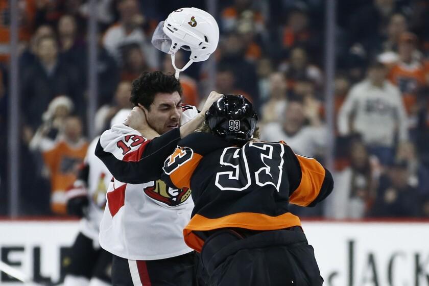 Ottawa Senators' Nick Paul, left, and Philadelphia Flyers' Jakub Voracek fight during the first period of an NHL hockey game, Saturday, Dec. 7, 2019, in Philadelphia. (AP Photo/Matt Slocum)
