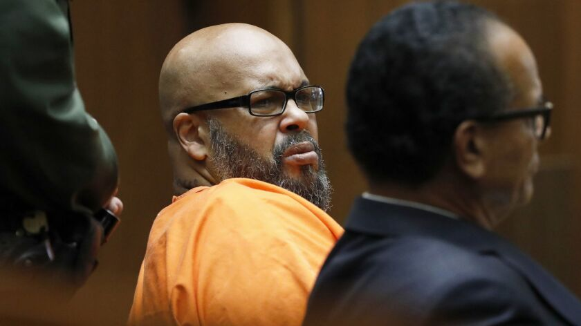 "Former rap mogul Marion ""Suge"" Knight, left, with his defense attorney Albert DeBlanc Jr., listens t"