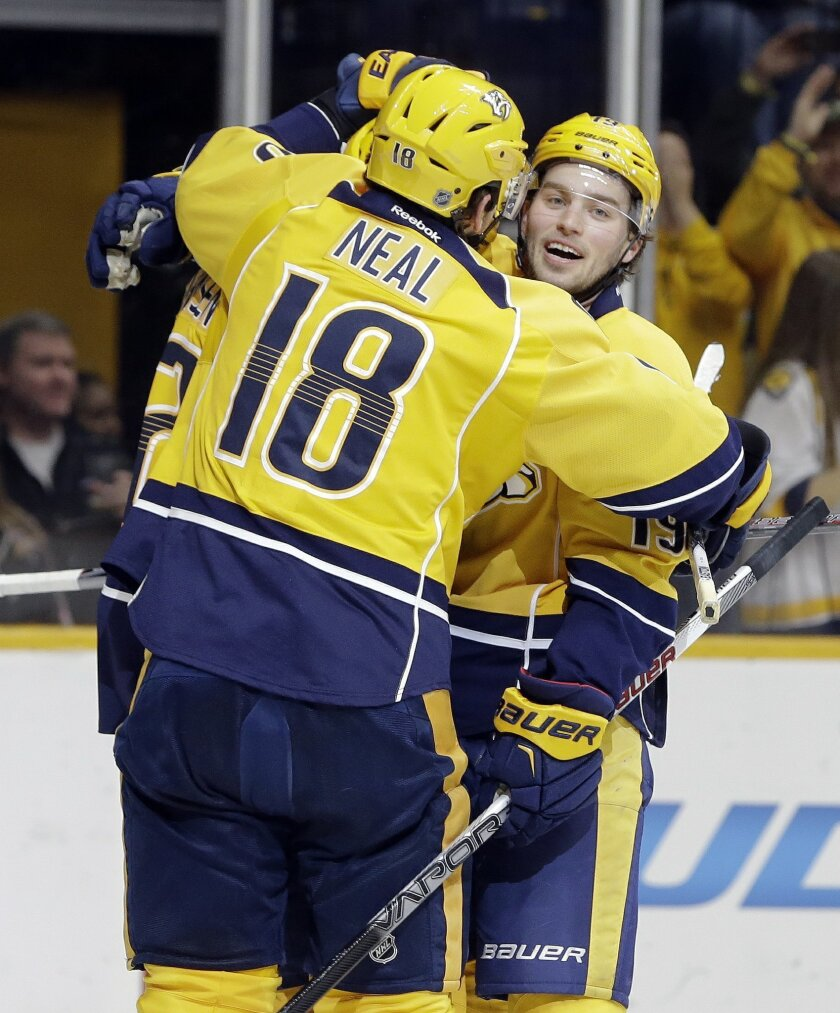 Nashville Predators center Calle Jarnkrok, of Sweden, right, is congratulated by James Neal (18) after Jarnkrok scored a goal against  the San Jose Sharks in the second period of an NHL hockey game Saturday, Feb. 6, 2016, in Nashville, Tenn. (AP Photo/Mark Humphrey)