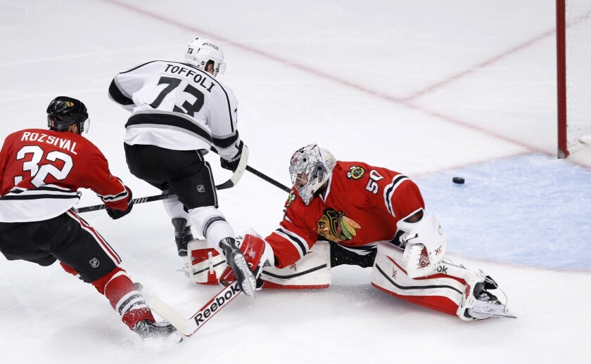 Kings forward Tyler Toffoli watches his shot head toward the post after beating Blackhawks defenseman Michal Rozsival and goalie Corey Crawford in the third period.