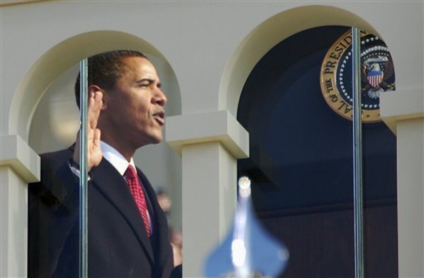Barack Obama takes the oath of office to become the 44th president of the United States in Washington, Tuesday, Jan. 20, 2009.   (AP Photo/Robert Glass)