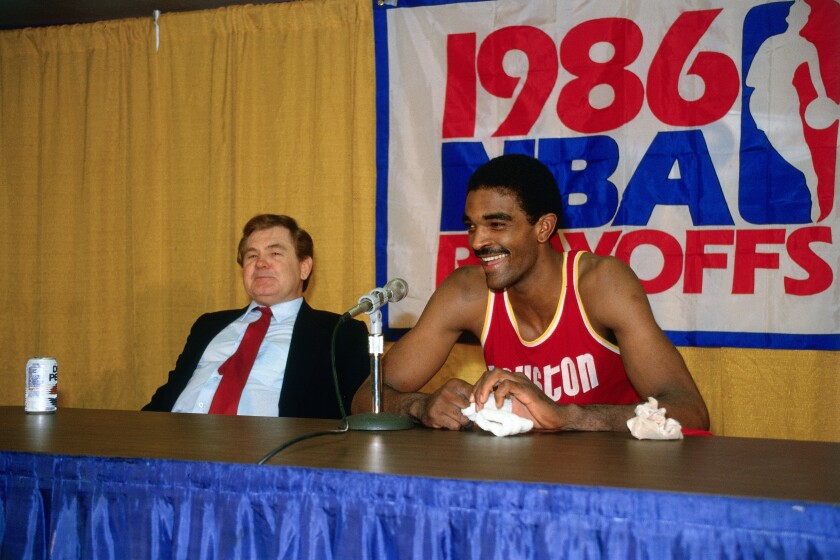 Houston Rocket Ralph Sampson and coach Bill Fitch talk during a 1986 NBA playoff series against the Lakers at the Forum.