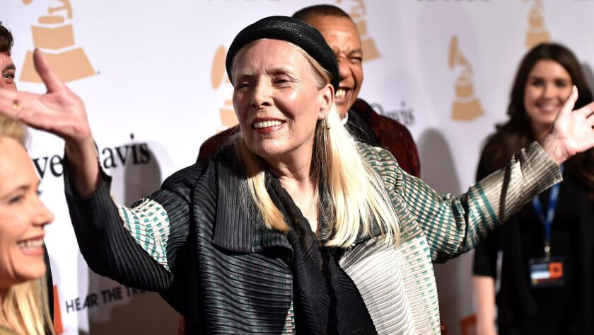 Joni Mitchell arrives at the Clive Davis Pre-Grammy Gala in Beverly Hills on Feb. 7, 2015.