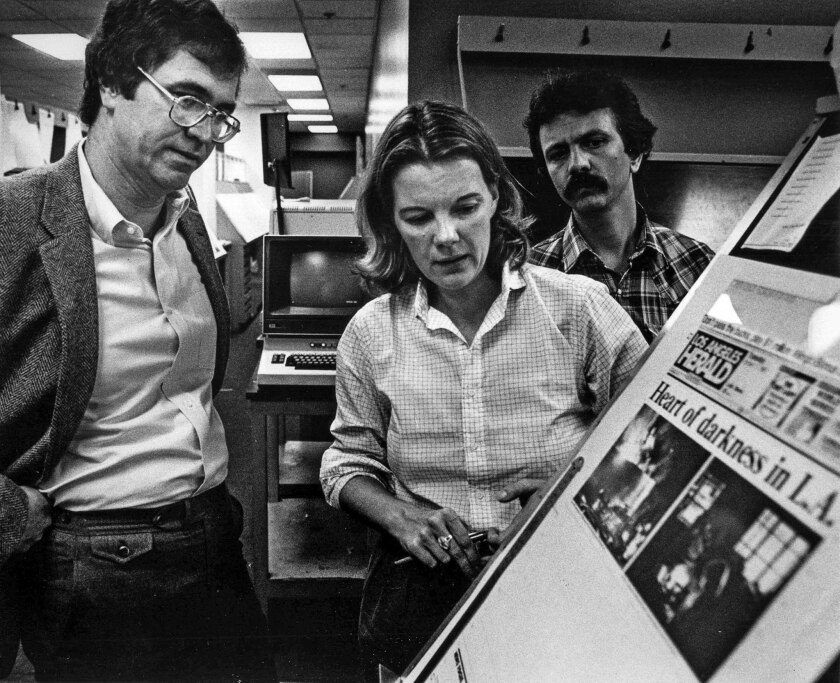 Oct. 11, 1983: L.A. Times publisher Tom Johnson and L.A. Herald Examiner editor Mary Anne Dolan check out the front page of the Herald being printed at The Times due to a major power outage.