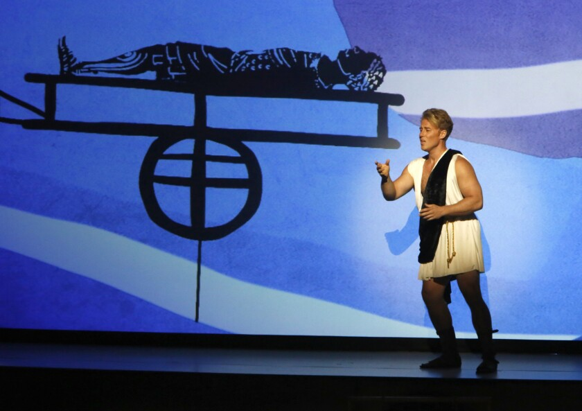 """Adam Fisher portrays the """"Young Caesar"""" title character in a one-night presentation brought to life with animated projections and shadow puppets."""