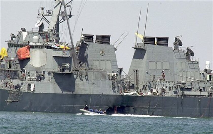 Oct. 15, 2000 AP file photo of the damaged hull of the USS Cole
