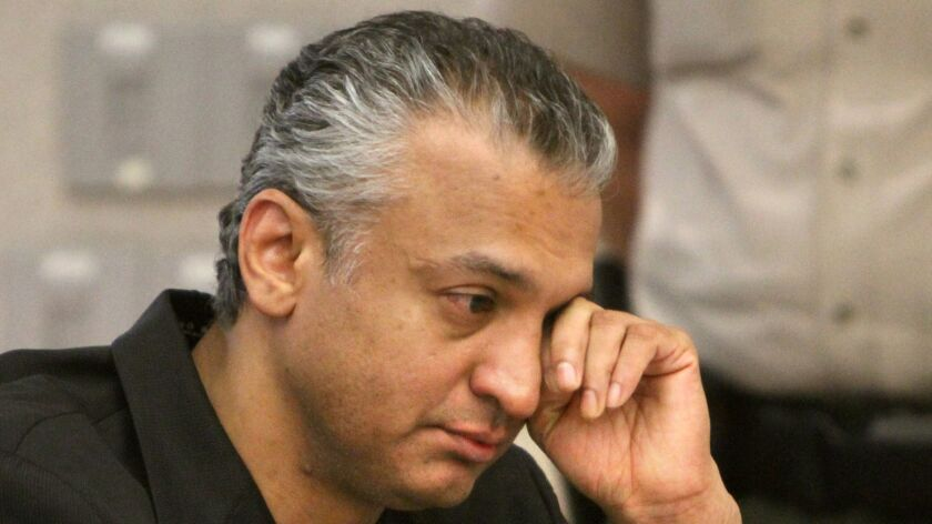 December 16, 2010, Vista, CA, USA_At the Vista Courthouse former actor Shelley Malil wipes tears dur