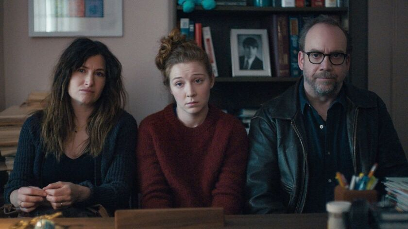"Kathryn Hahn, left, Kayli Carter and Paul Giamatti in a scene from ""Private Life."""
