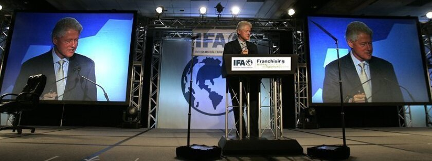 Former President Bill Clinton delivers the keynote address during the general meeting of the International Franchise Association convention at the Manchester Grand Hyatt Hotel on Sunday, Feb. 15, 2009.
