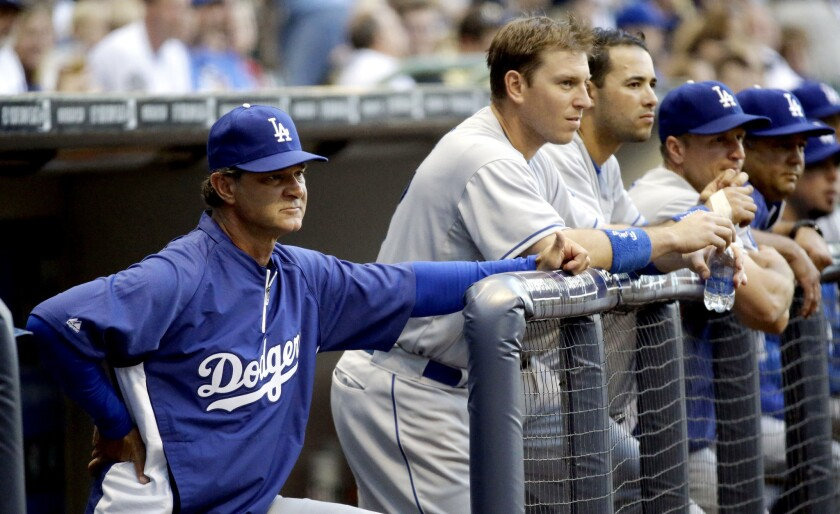 Dodgers Manager Don Mattingly watches from the dugout during a game against the Milwaukee Brewers.