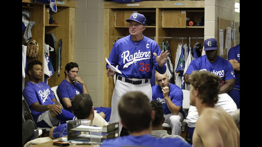 Ogden Raptors Manager John Shoemaker (center) talks to his players before a game against Montana on July 17.