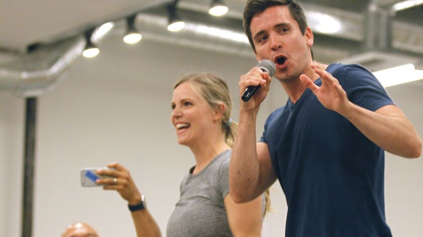 "Katie Rose Clarke and Matt Doyle perform during a rehearsal of ""The Heart of Rock & Roll."""