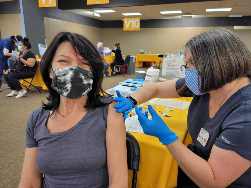 A teacher gets vaccinated at the Sharp HealthCare Vaccination Superstation in Chula Vista on Saturday.