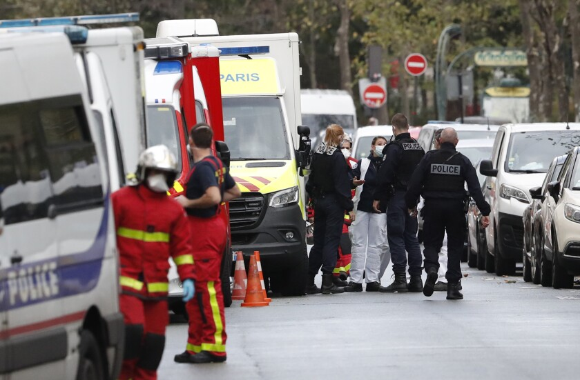 Police and rescue workers near the scene of a Paris knife attack Friday