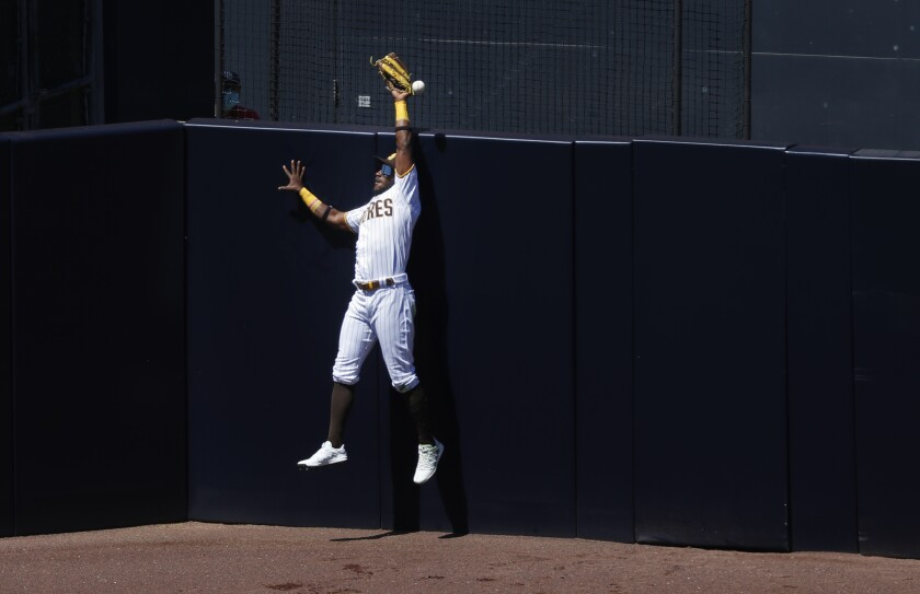 Padres center fielder Jorge Mateo can't make the catch on a two-run homer by the San Francisco Giants' Darin Ruf.