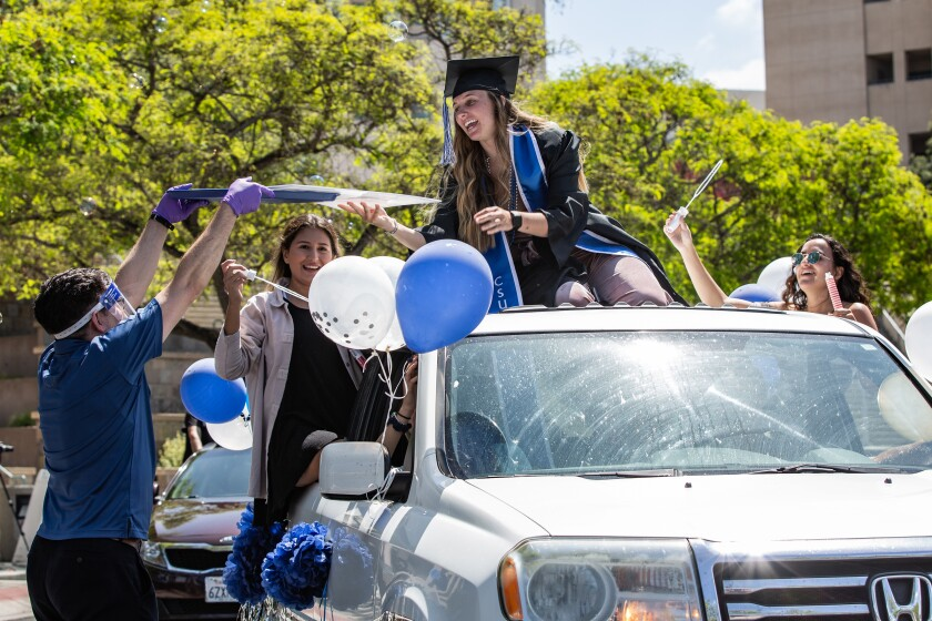 The staff and faculty of Cal State San Marcos celebrated the Class of 2020 with a parade on Friday in San Marcos. In Los Angeles County, public health officials have warned against gatherings, even when people remain in their cars.