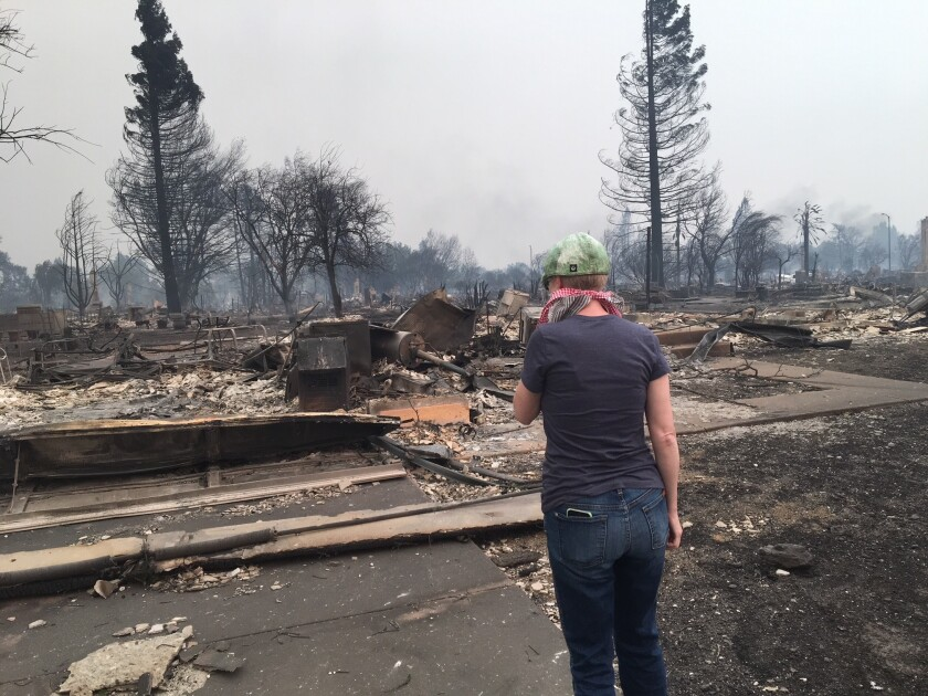 Sanaz Kiesbye surveys what's left of her home after the Tubbs fire in 2017. The blaze decimated the Coffey Park neighborhood in Santa Rosa.