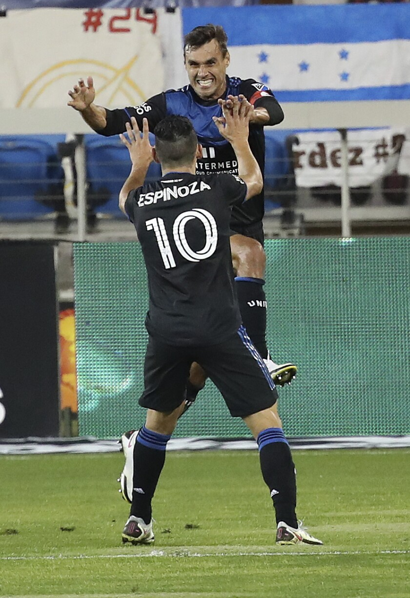 San Jose Earthquakes forward Cristian Espinoza (10) celebrates with forward Chris Wondolowski, who scored a goal against the Real Salt Lake during the first half of an MLS soccer match Wednesday, Oct. 28, 2020, in San Jose, Calif. (AP Photo/Josie Lepe)
