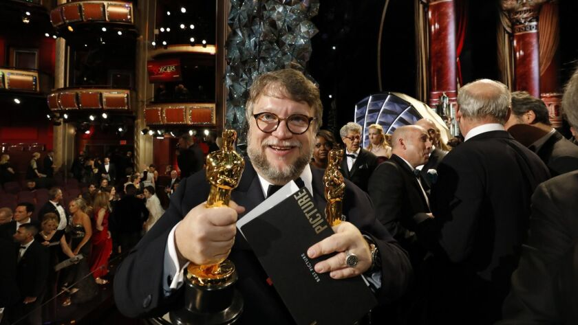 """Guillermo del Toro holds the two Oscars he won for """"The Shape of Water"""" at the Academy Awards on March 4 at the Dolby Theatre in Hollywood."""