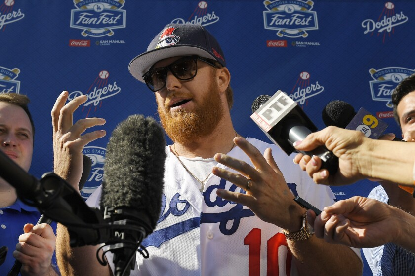 Dodgers third baseman Justin Turner is interviewed by reporters during Dodgers FanFest on Jan. 25, 2020, at Dodger Stadium.