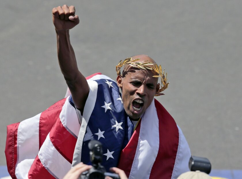 Meb Keflezighi, of San Diego, Calif., celebrates his victory in the 118th Boston Marathon Monday, April 21, 2014 in Boston. (AP Photo/Charles Krupa)