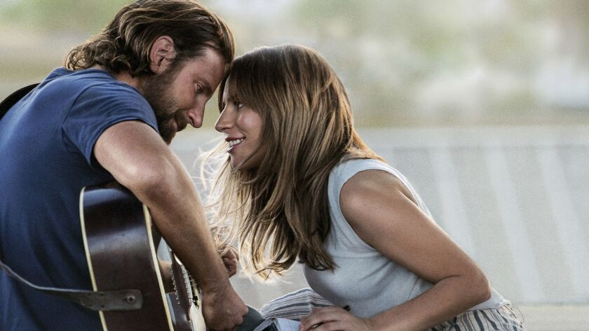 "This image released by Warner Bros. Pictures shows Bradley Cooper, left, and Lady Gaga in a scene from ""A Star is Born."""