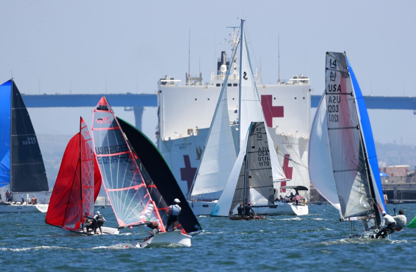 Sailors racing one-design dinghies navigate San Diego Bay on Sunday on the eve of a Pacific storm in Southern California