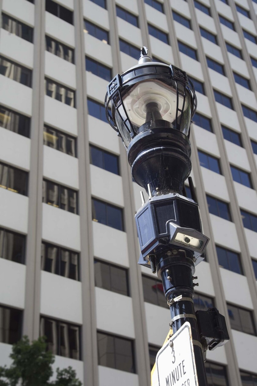 """The city of San Diego has already installed thousands of """"Smart Street Lamps"""" that include an array of sensors including video and audio that is used by law enforcement and other city entities. On a street lamp downtown, a module below the light houses the cameras, antennas and other instruments."""
