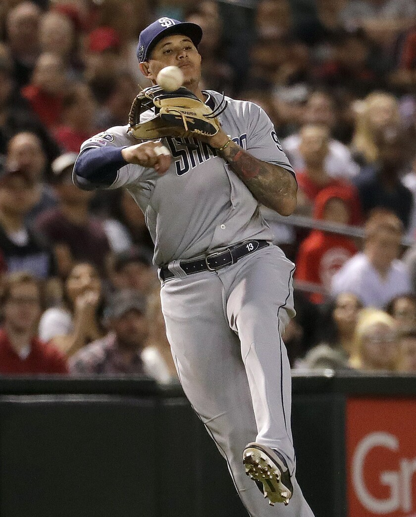 Padres third baseman Manny Machado throws to first for the first out of the eighth inning in Friday night's 2-1 victory over the Diamondbacks.