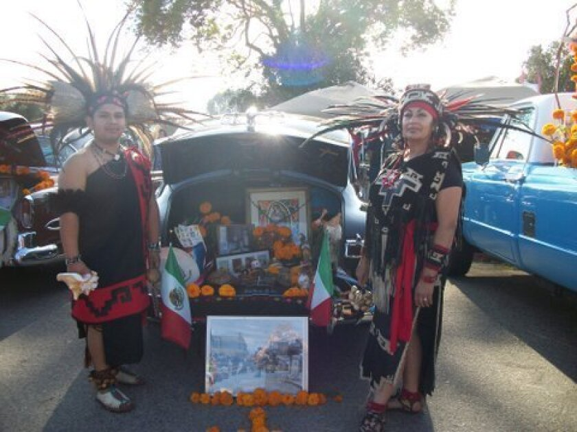 An ofrenda built out of a car trunk for Dia de los Muertos. The Por Siempre Car Club will put on a classic car show with trunk altar displays for the 14th annual Dia de los Muertos at Mission San Luis Rey Oct. 26.