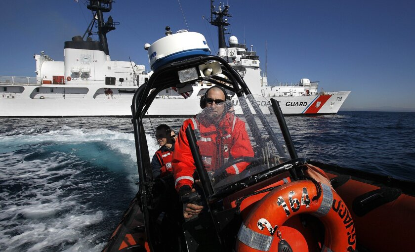 Boatswain's mate Cale Silva pulls a fast boat into a turn after leaving the Coast Guard cutter Boutwell during a drill. The cutter returned recently from an anti-drug deployment to South America.
