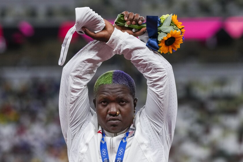 Shot putter Raven Saunders crosses her arms over her head at the Toyo Olympics.