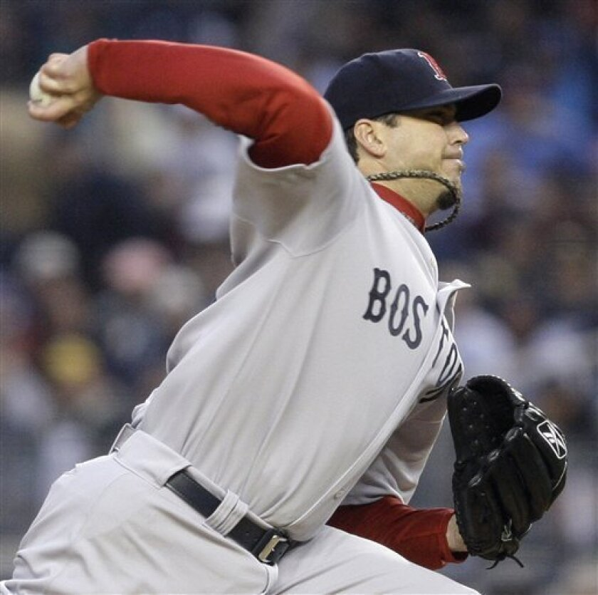 Boston Red Sox's Josh Beckett delivers against the New York Yankees in the first inning of a baseball game Tuesday, May 5, 2009, at Yankee Stadium in New York. (AP Photo/Julie Jacobson)