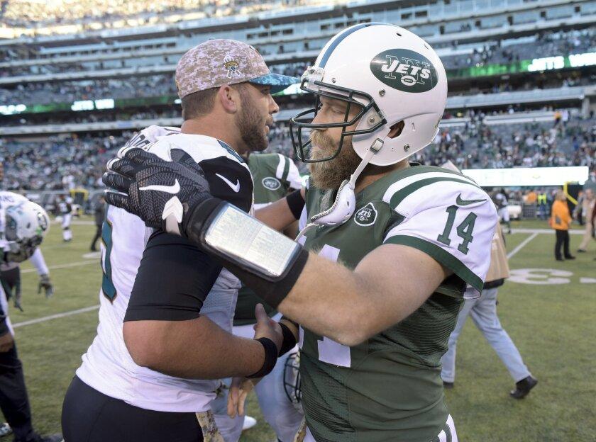 New York Jets quarterback Ryan Fitzpatrick (14) greets Jacksonville Jaguars quarterback Blake Bortles (5) after the Jets beat the Jaguars 28-23 in an NFL football game, Sunday, Nov. 8, 2015, in East Rutherford, N.J. (AP Photo/Bill Kostroun)