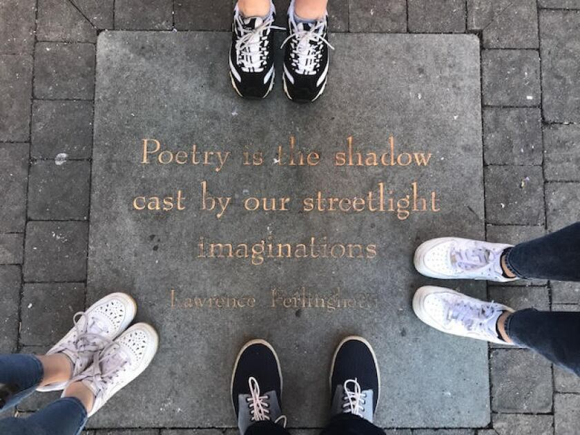 A family poses outside City Lights Bookstore in San Francisco on Jan. 2, 2020.