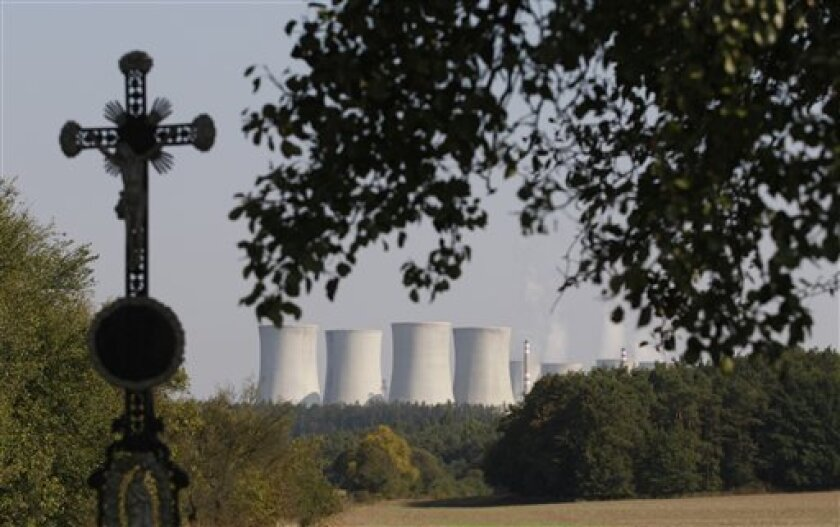 In this photo taken Sept. 27, 2011, the Dukovany nuclear power plant dominates the scene set in the natural landscape at Dukovany, Czech Republic. Defying growing global skepticism over the use of atomic energy, Czech Republic is planning to dramatically increase the country's nuclear power production, a move that would give the country a place among Europe's most nuclear-dependent nations. (AP Photo/Petr David Josek)