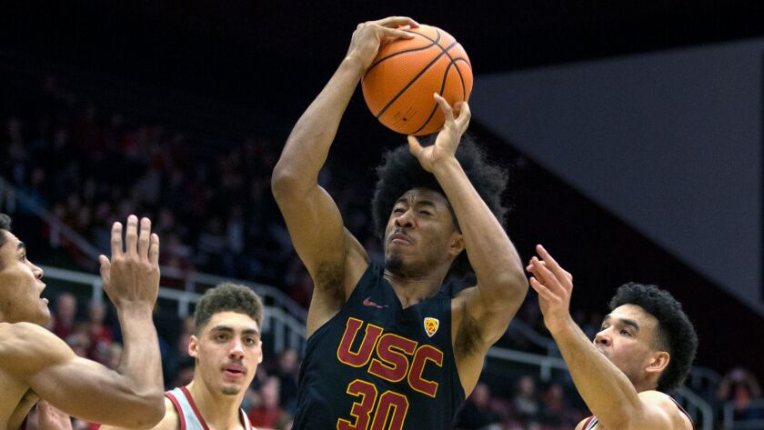 Southern California's Elijah Stewart (30) drives to the basket amid Stanford defenders during the first half.