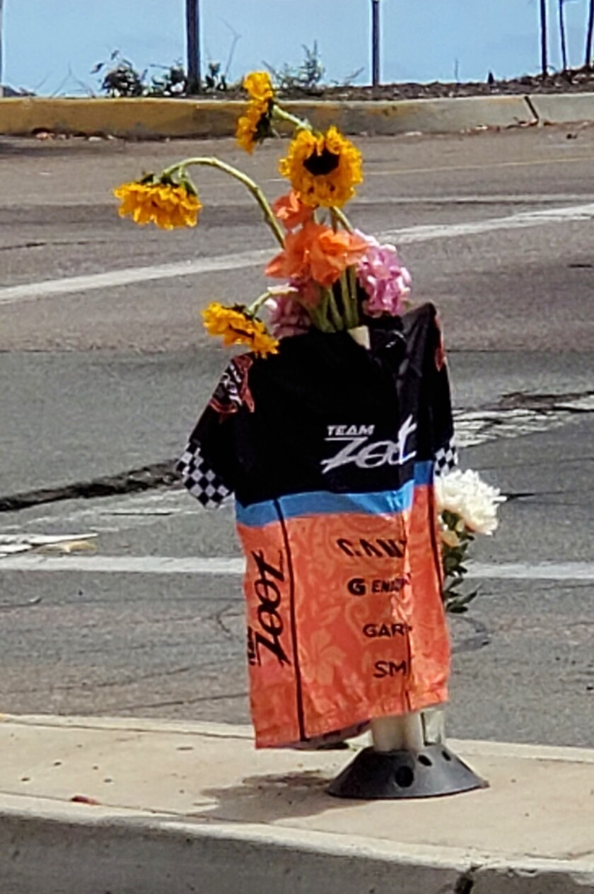 Flowers and a cycling jersey mark where 34-year-old bicyclist Swati Tyagi died after being struck by a car in La Jolla.